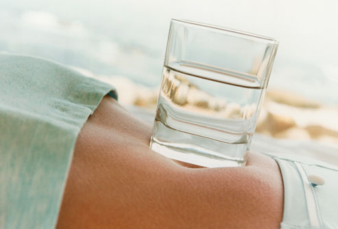 getty_rm_photo_of_glass_of_water_on_belly