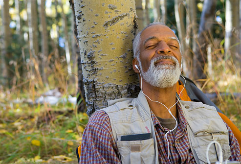 getty_rr_photo_of_man_relaxing_in_woods