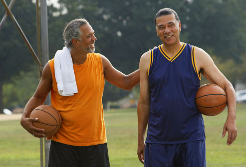photolibrary_rf_photo_of_two_men_on_basketball_court