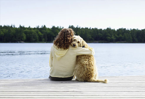 photolibrary_rf_photo_of_woman_with_dog_on_jetty