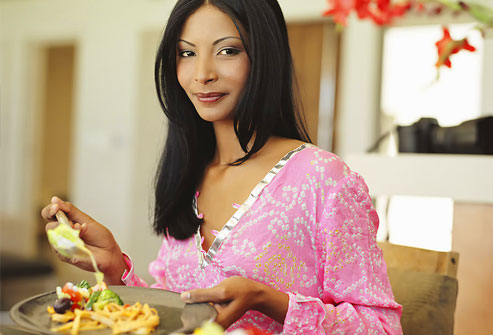 photolibrary_rf_photo_of_woman_with_plate_of_food