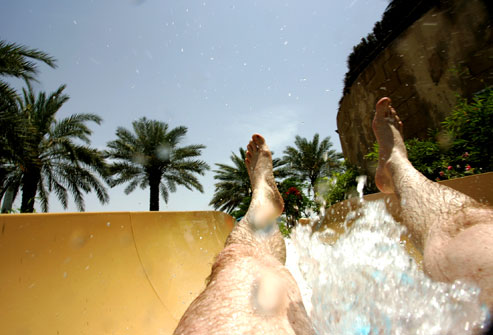 photolibrary_rm_photo_of_man_going_down_waterslide