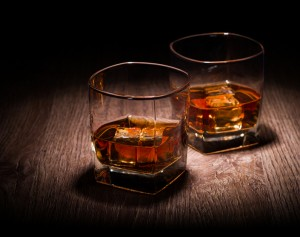 whiskey in glasses on wooden table